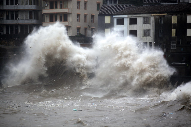 A strong wave breaks along the shore ahead of the landfall of Typhoon Chan-Hom in Wenling in eastern China's Zhejiang province Friday July 10, 2015. (Photo by Chinatopix via AP Photo)