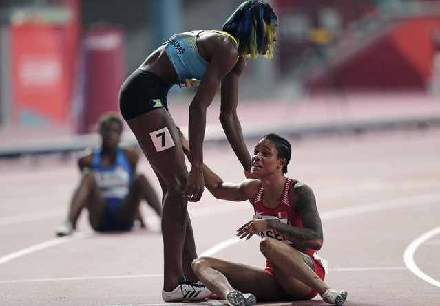 Salwa Eid Naser, of Bahrain, right, reacts after winning the gold medal while being congratulated by greeted by silver medalist Shaunae Miller-Uibo, of Bahamas, after the women's 400 meter final and is at the World Athletics Championships in Doha, Qatar, Thursday, October 3, 2019. (Photo by Nariman El-Mofty/AP Photo)