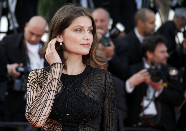 "Actress Laetitia Casta poses on the red carpet as she arrives for the screening of the film ""La fille inconnue"" (The Unknown Girl) in competition at the 69th Cannes Film Festival in Cannes, France, May 18, 2016. (Photo by Jean-Paul Pelissier/Reuters)"