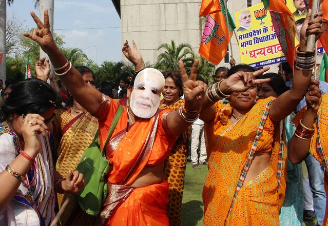 Bharatiya Janata Party supporters celebrate their party's victory in Bhopal, on May 16, 2014. (Photo by Sanjeev Gupta/EPA)
