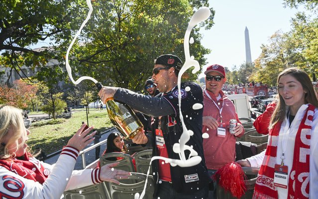 Nationals first baseman Ryan Zimmerman, center, pours champagne before the start of a parade to honor the team's first World Series championship in Washington, D.C. on November 2, 2019. (Photo by Toni L. Sandys/The Washington Post)