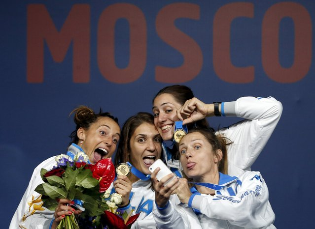 Winners of the women's team foil competition (L-R) Italy's Elisa Di Francisca, Arianna Errigo, Martina Batini and Valentina Vezzali pose for a picture during a medal ceremony at the World Fencing Championships in Moscow, Russia, July 19, 2015. (Photo by Grigory Dukor/Reuters)