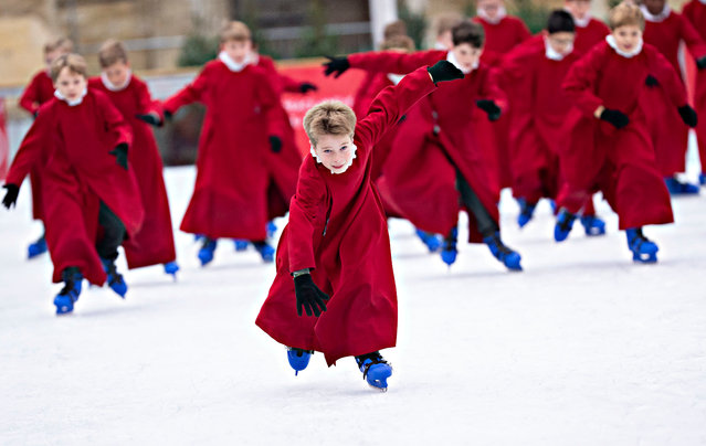 Choristers take to the ice before the public opening of a rink at the city's cathedral in Winchester, England on November 20, 2019. (Photo by David Hartley/Rex Features/Shutterstock)