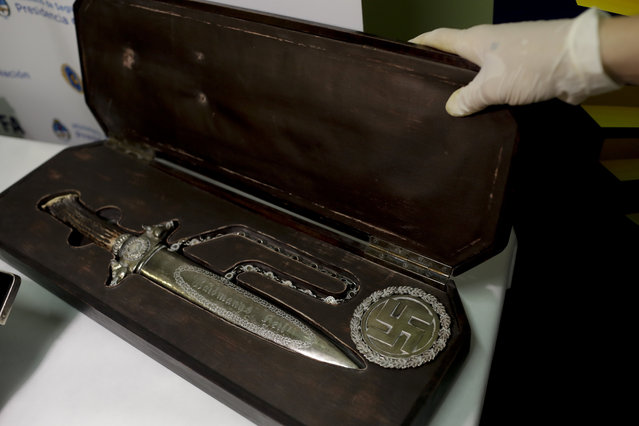 A knife with Nazi markings is seen at the Interpol headquarters in Buenos Aires, Argentina, Friday, June 16, 2017. (Photo by Natacha Pisarenko/AP Photo)