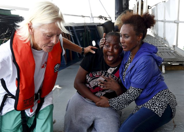 Migrants react after boarding the Migrant Offshore Aid Station (MOAS) ship MV Phoenix some 20 miles (32 kilometres) off the coast of Libya, August 3, 2015. (Photo by Darrin Zammit Lupi/Reuters)