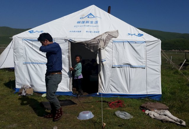 Tibetan herdsmen family live in a tent during summer in Aba Tibetan and Qiang Autonomous Prefecture, Sichuan province, August 1, 2015. (Photo by Natalie Thomas/Reuters)