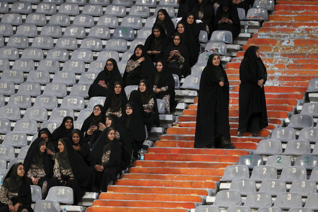 Female police officers work at the Azadi (Freedom) Stadium during a soccer match between Iran and Cambodia in the 2022 World Cup qualifier in Tehran, Iran, Thursday, October 10, 2019. Iranian women were freely allowed into the stadium for the first time in decades. The decision follows the death of a young woman who set herself on fire after hearing she could face prison time for sneaking into an Iranian soccer match disguised as a man. (Photo by Vahid Salemi/AP Photo)