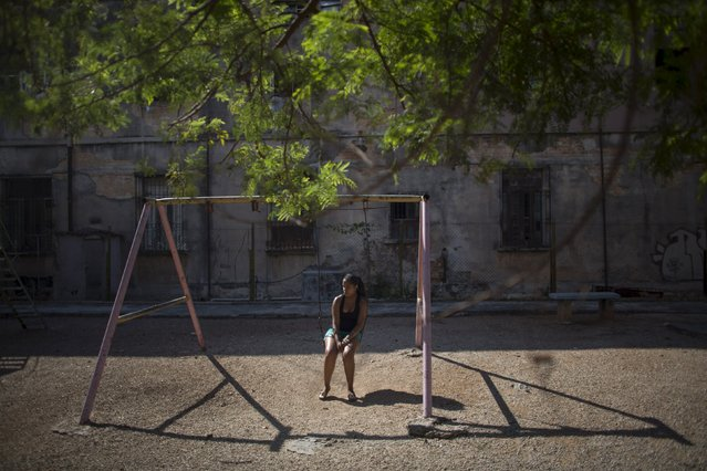 Social worker Stefani Gomes, 20, sits on a swing at a playground in Havana, May 6, 2015. (Photo by Alexandre Meneghini/Reuters)