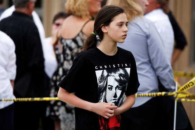 A supporter of musician Christina Grimmie waits for a memorial service, a day after the singer was buried, in Medford, New Jersey, June 17, 2016. (Photo by Dominick Reuter/Reuters)