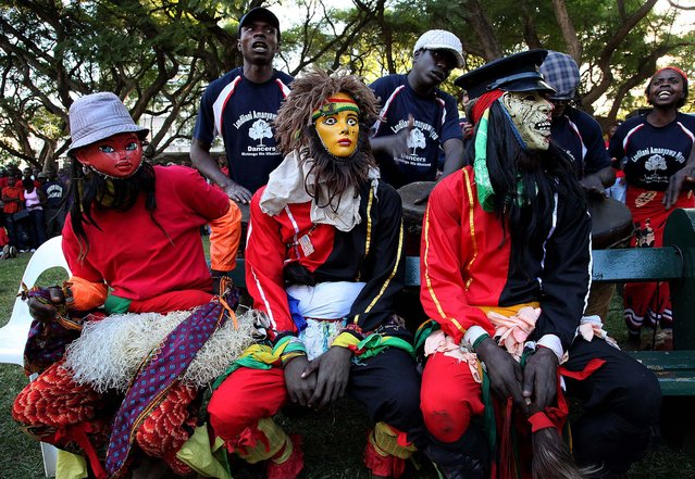 Members of the Landilani Amanyawa Nyau dance group wait to perform during Africa Day commemorations held in Harare on May 25, 2012