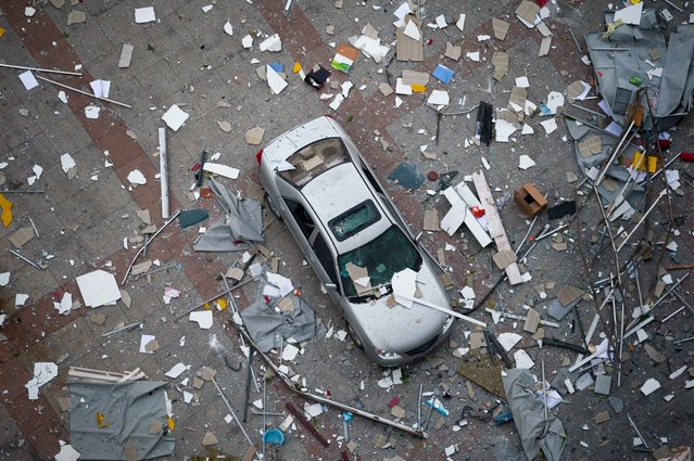 A car is seen in the debris following the explosions of a warehouse in Binhai New Area on August 13, 2015 in Tianjin, China. (Photo by ChinaFotoPress/ChinaFotoPress via Getty Images)