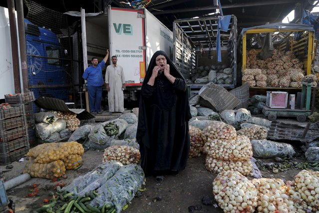 A woman reacts at the site of a truck bomb attack at a crowded market in Baghdad August 13, 2015. (Photo by Wissm Al- Okili/Reuters)