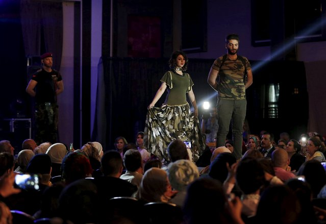 Models present creations by Iraqi designer Waffa Al-Shathar during a fashion show at the Hunting Club in Baghdad August 13, 2015. (Photo by Thaier al-Sudani/Reuters)