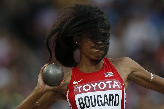 """USA's Erica Bougard competes in the shot put in the womens heptathlon athletics event at the 2015 IAAF World Championships at the """"Bird's Nest"""" National Stadium in Beijing on August 22, 2015. (Photo by Adrian Dennis/AFP Photo)"""