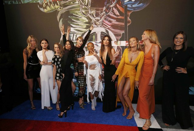 From left, model Martha Hunt, actress Hailee Steinfeld, model Cara Delevingne, recording artists Selena Gomez and Taylor Swift, actress Serayah McNeill, models Lily Aldridge, Gigi Hadid and Karlie Kloss, and actress Mariska Hargitay arrive together at the 2015 MTV Video Music Awards in Los Angeles, California August 30, 2015. (Photo by Mario Anzuoni/Reuters)
