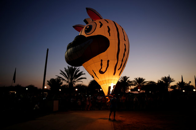 A hot air balloon, attached to a stuffed toy, is presented during a two-day international hot air balloon festival in Eshkol Park near the southern city of Netivot, Israel July 22, 2016. (Photo by Amir Cohen/Reuters)