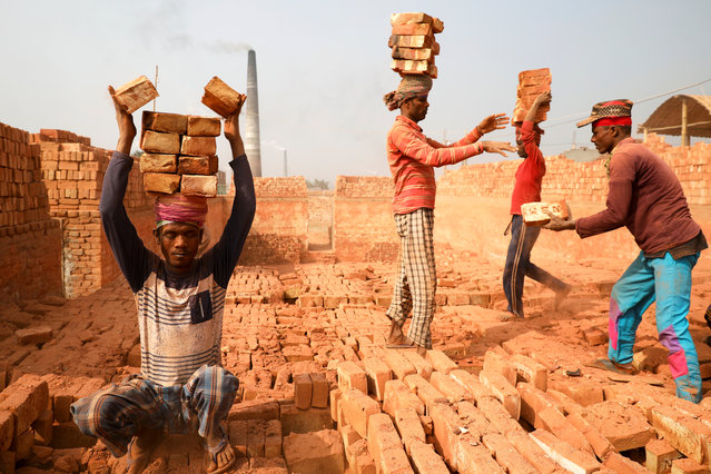 People are working in a brick kiln in Narayanganj, Bangladesh, January 8, 2020. (Photo by Mohammad Ponir Hossain/Reuters)