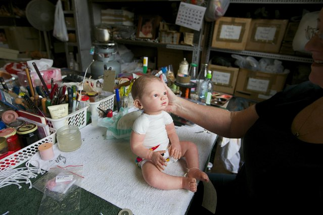 A damaged doll is pictured on a workbench after having its head re-attached by 25-year veteran doll repairer Kerry Stuart at Sydney's Doll Hospital, July 15, 2014. Opened in 1913, Sydney's Doll Hospital has worked on millions of dolls, teddy bears and other toys. (Photo by Jason Reed/Reuters)