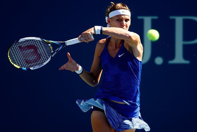 Lucie Safarova of the Czech Republic returns a shot against Alize Cornet of France during their women's singles third round match on Day Five of the 2014 US Open at the USTA Billie Jean King National Tennis Center on August 29, 2014 in the Flushing neighborhood of the Queens borough of New York City. (Photo by Julian Finney/Getty Images)