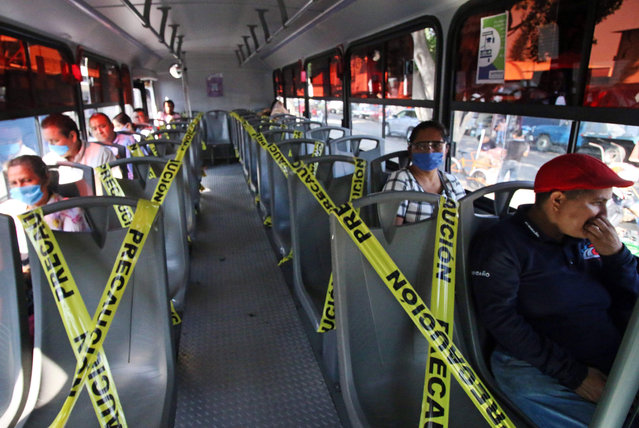 Commuters travel on a bus with seats marked off to maintain social distancing as a preventive measure against the spread of the novel coronavirus COVID-19, in Oaxaca, Mexico, on April 29, 2020. (Photo by Patricia Castellanos/AFP Photo)