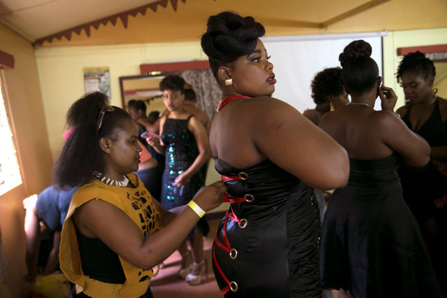 A model gets final adjustments back stage before participating in a plus size fashion show in Nairobi, Kenya, October 7, 2017. (Photo by Baz Ratner/Reuters)