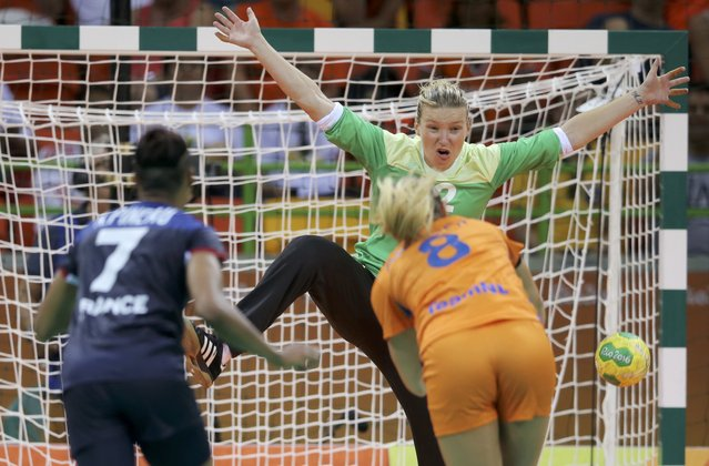 2016 Rio Olympics, Handball, Preliminary, Women's Preliminary Group B Netherlands vs France, Future Arena, Rio de Janeiro, Brazil on August 6, 2016. Goalkeeper Amandine Leynaud (FRA) of France, Allison Pineau (FRA) of France and Lois Abbingh (NED) of Netherlands in action. (Photo by Marko Djurica/Reuters)