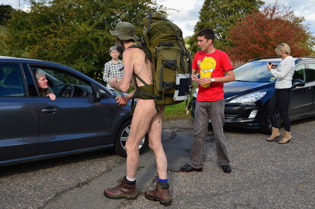 Stephen Gough the naked rambler chats to motorists as makes his way south through Peebles in the Scottish Borders, following his release from Saughton Prison yesterday after serving his latest sentence on October 6, 2012 in Peebles, Scotland. The rambler has 18 convictions and has been in prison on and off since 2006 with offences ranging from not wearing clothes in front of the sheriff, breach of the peace and contempt of court.  (Photo by Jeff J. Mitchell)
