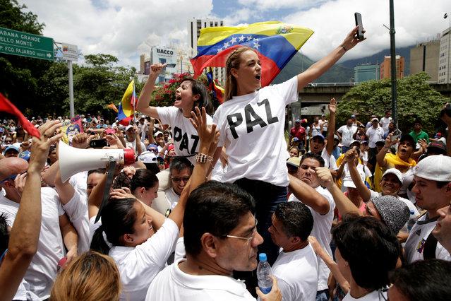 Lilian Tintori (R), wife of jailed Venezuelan opposition leader Leopoldo Lopez, takes part in a rally to demand a referendum to remove Venezuela's President Nicolas Maduro in Caracas, Venezuela, September 1, 2016. (Photo by Marco Bello/Reuters)