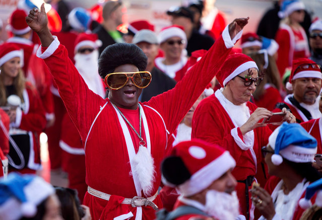 Entertainer Larry Edwards participates in the 13th annual Las Vegas Great Santa Run in downtown Las Vegas, Nevada, U.S. December 2, 2017. More than 9,000 runners registered for the event, according to organizers. (Photo by Steve Marcus/Reuters/Las Vegas Sun)