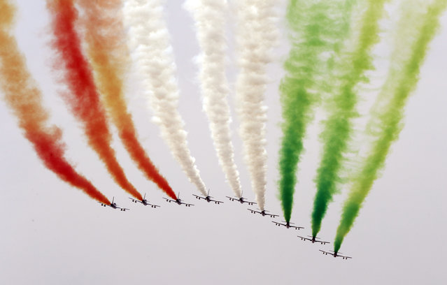 "The ""Frecce Tricolori"" Italian Air Force acrobatic squad fly over the Monza racetrack prior to the start of the Italian Formula One Grand Prix at, Italy, Sunday, September 4, 2016. (Photo by Luca Bruno/AP Photo)"