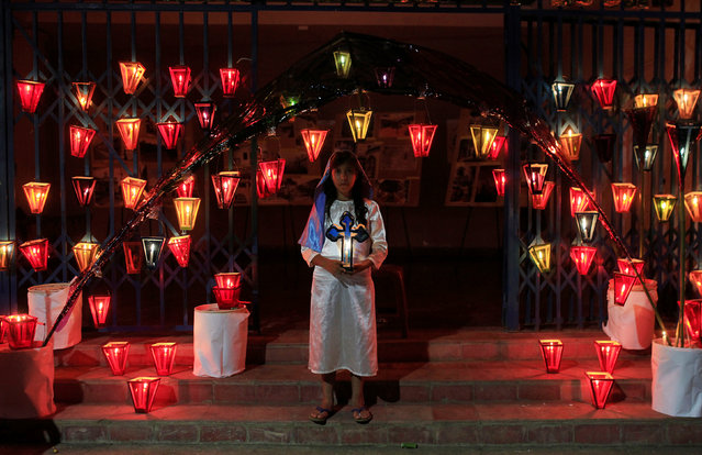A girl dressed as the Virgin Mary pose for a photo during the Lantern Festival celebrating the eve of the nativity of the Virgin Mary in Ahuchapan, El Salvador September 7, 2016. (Photo by Jose Cabezas/Reuters)