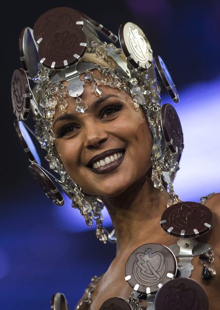 A model presents a creation made of chocolate at the 20th Salon du Chocolat (Paris Chocolate Fair) in Paris, France, 28 October 2014.  The fair runs from 29 October to 02 November 2014. (Photo by Ian Langsdon/EPA)