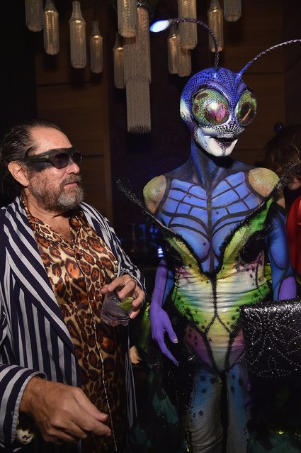 Heidi Klum (R) and guests attend Moto X presents Heidi Klum's 15th Annual Halloween Party sponsored by SVEDKA Vodka at TAO Downtown on October 31, 2014 in New York City. (Photo by Mike Coppola/Getty Images for Heidi Klum)