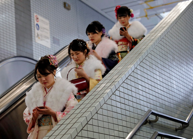 Japanese women wearing kimonos ride an escalator at a subway station after attending their Coming of Age Day celebration ceremony in Tokyo, Japan January 8, 2018. (Photo by Kim Kyung-Hoon/Reuters)