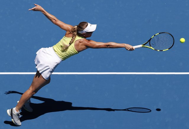 Denmark' s Caroline Wozniacki hits a return against Croatia' s Jana Fett during their women' s singles second round match on day three of the Australian Open tennis tournament in Melbourne on January 17, 2018. (Photo by Issei Kato/Reuters)