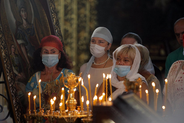 Devotees wear mandatory face masks during the divine liturgy at St Michael's Golden-Domed Cathedral on the Feast of the Transfiguration in Kyiv, capital of Ukraine on August 19, 2020. (Photo by Evgen Kotenko/Ukrinform/Barcroft Media via Getty Images)