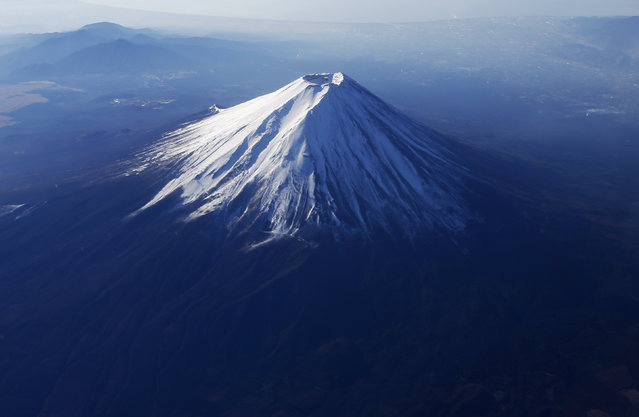 Japan's Mount Fuji is seen covered with snow. (Photo by Issei Kato/Reuters)