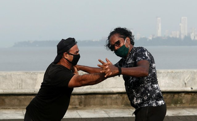 People wearing protective masks exercise at a promenade amidst the spread of the coronavirus disease (COVID-19) in Mumbai, India, September 9, 2020. (Photo by Francis Mascarenhas/Reuters)