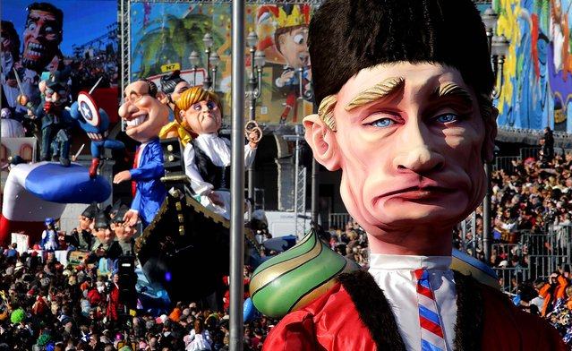 Floats depicting Russia's President Vladimir Putin, right, German Chancellor Angela Merkel and French President Francois Hollande parade during the 129th edition of the Nice Carnival in southern France, February 19, 2013. (Photo by Lionel Cironneau/Associated Press)
