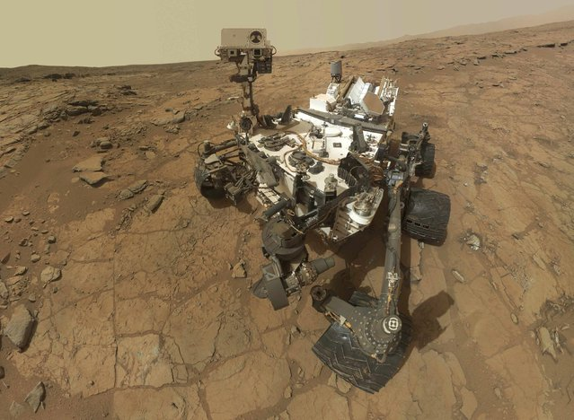 """Self-portrait of the rover Curiosity, combining dozens of exposures taken by the rover's Mars Hand Lens Imager (MAHLI) during the 177th Martian day, or sol, is seen in this February 3, 2013 handout image courtesy of NASA. The rover is positioned at a patch of flat outcrop called """"John Klein"""", which was selected as the site for the first rock-drilling activities by Curiosity. The rover's robotic arm is not visible in the mosaic. (Photo by NASA/Reuters/JPL-Caltech/MSSS/Handout)"""
