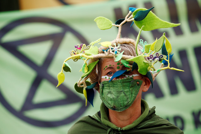An Extinction Rebellion activist takes part in a protest in Berlin, Germany on October 5, 2020. (Photo by Michele Tantussi/Reuters)