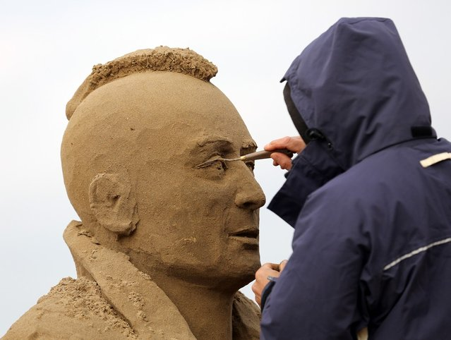 A sand sculptor works on a Robert De Niro in Taxi Driver sand sculpture as pieces are prepared as part of this year's Hollywood themed annual Weston-super-Mare Sand Sculpture festival on March 26, 2013 in Weston-Super-Mare, England. Due to open on Good Friday, currently twenty award winning sand sculptors from across the globe are working to create sand sculptures including Harry Potter, Marilyn Monroe and characters from the Star Wars films as part of the town's very own movie themed festival on the beach.  (Photo by Matt Cardy)