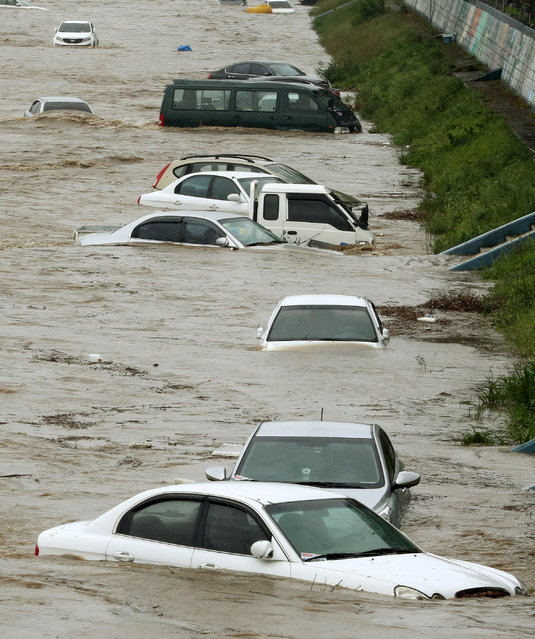Cars are submerged in flood waters caused by Typhoon Chaba in Gyeongju, South Korea, October 5, 2016. (Photo by Kim Jun-beom/Reuters/Yonhap)