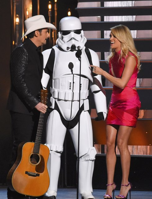 "Show hosts Brad Paisley and Carrie Underwood perform their monologue with a ""Storm trooper"" onstage at the 49th Annual Country Music Association Awards in Nashville, Tennessee November 4, 2015. (Photo by Harrison McClary/Reuters)"