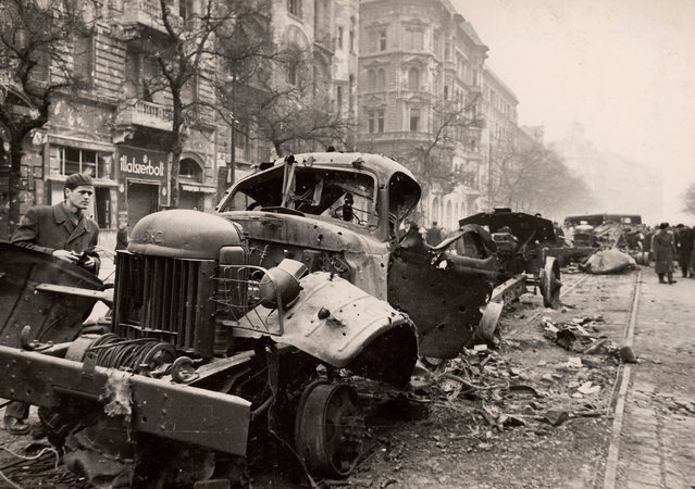 A general view shows the wreckage of armed trucks on the streets of Budapest at the time of the uprising against the Soviet-supported Hungarian communist regime in 1956. The picture was taken in the period between October 23 and November 4, 1956. (Photo by Laszlo Almasi/Reuters)