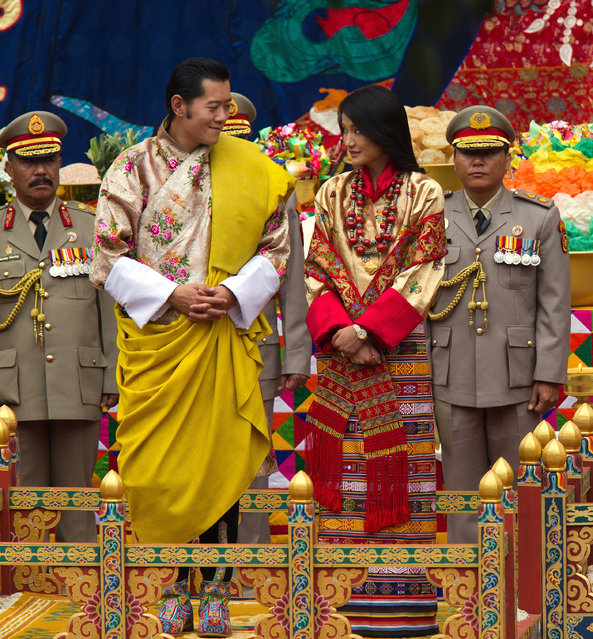 His majesty King Jigme Khesar Namgyel Wangchuck (L), 31, smiles at his bride during the purification marriage ceremony to Queen Jetsun Pema, 21, in the historical Punakha Dzong on October 13, 2011 in Punakha, Bhutan. The Dzong is the same venue that hosted the King's historic coronation ceremony in 2008. The Oxford-educated king is popular in the country and the ceremony will be followed by celebration in the capital and countryside. (Photo by Paula Bronstein/Getty Images)