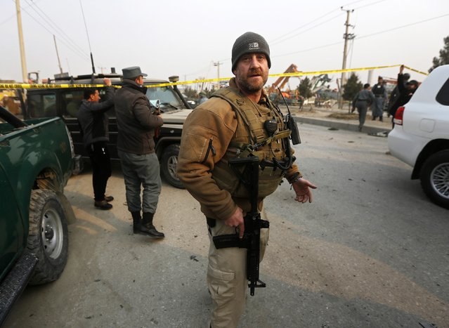 A member of the European Union Police Mission arrives at the site of a suicide attack in Kabul January 5, 2015. (Photo by Omar Sobhani/Reuters)
