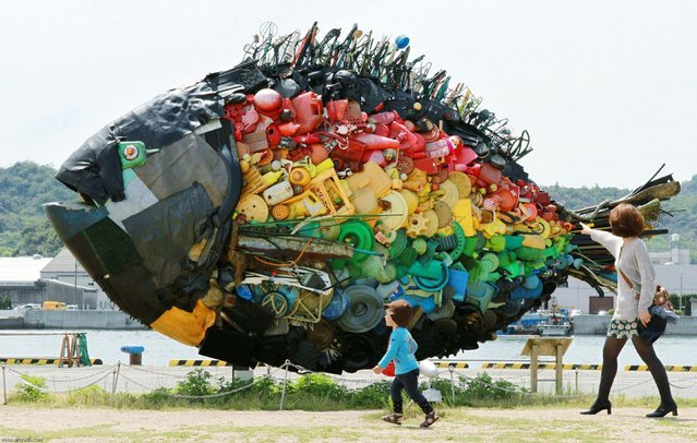 A large sea bream object, made from colourful debris found drifting at sea, such as plastic tanks, toys and wires, and produced by Japanese art group Yodogawa Tecnique, is displayed at the Setouchi Triennale art event at the port of Uno, Okayama prefecture in western Japan on May 19, 2013. (Photo by Jiji Pres/AFP Photo)