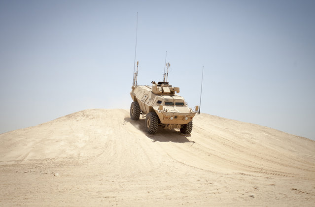 A Mobile Strike Force Vehicle assigned to the Afghan National Army Mobile Strike Force Kandak, navigates through a series of obstacles at a rough terrain driving course on Camp Bastion, Helmand province, on May 13, 2013. (Photo by Staff Sgt. Ezekiel R. Kitandwe/USMC)