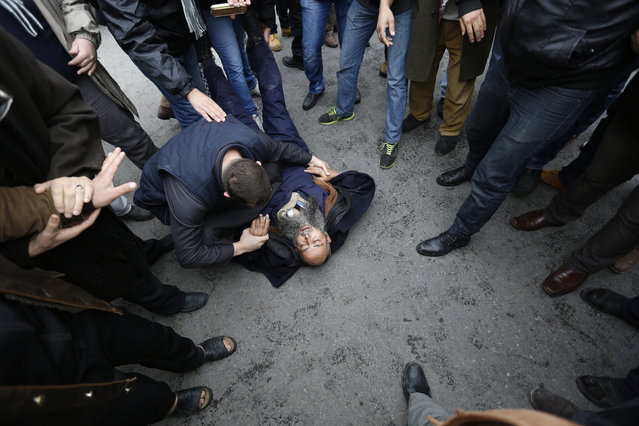 Demonstrators try to help a fellow demonstrator who fainted during a protest against satirical French weekly newspaper Charlie Hebdo, after the Friday prayer in Amman January 16, 2015. (Photo by Muhammad Hamed/Reuters)